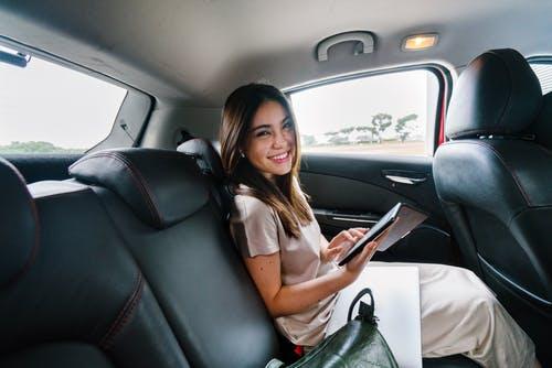 Woman Sitting Inside A Car