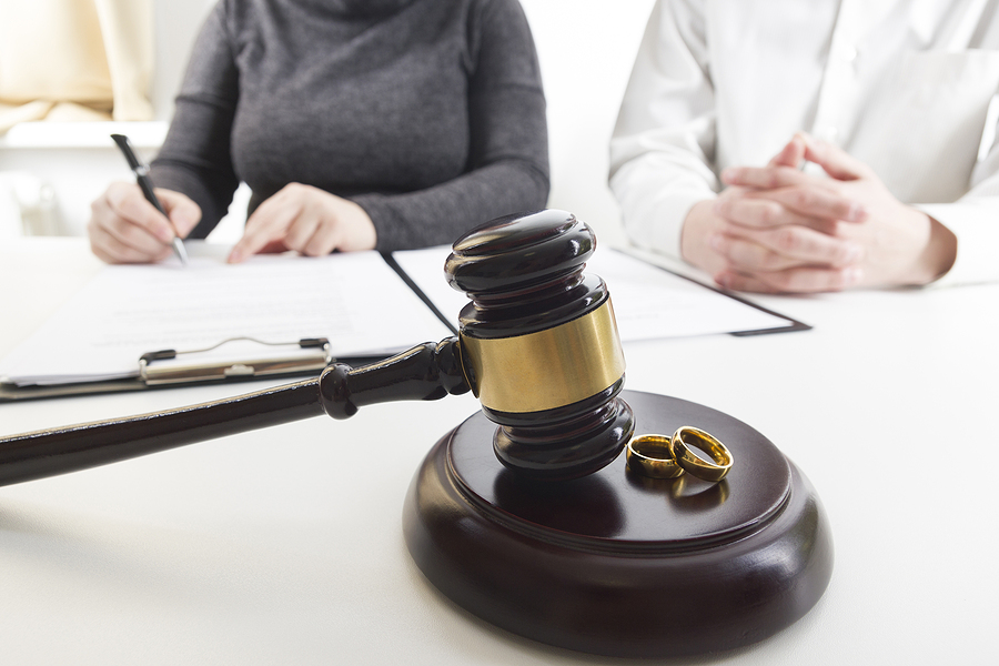 Family court in Sydney concept. Couple, wedding rings and a gavel