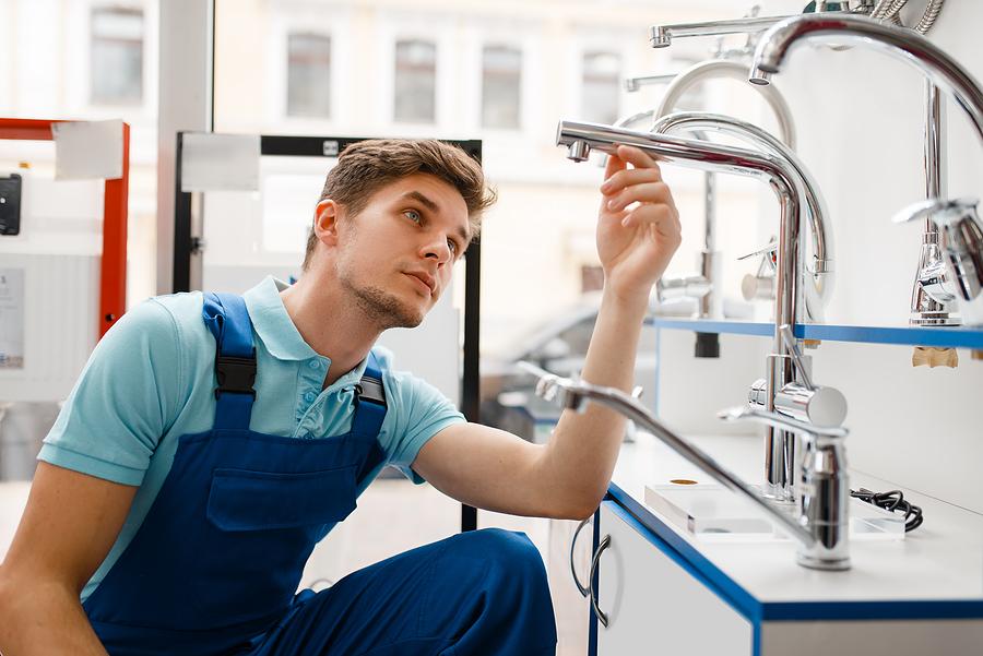 Plumber in Upper Hutt choosing a faucet inside a store