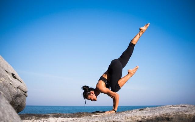 Woman teaching online yoga courses