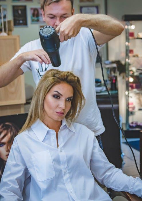 Woman getting Shiseido hair straightening treatment